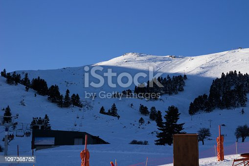istock snow ski and snowboard resort on a mountain view 1097368752