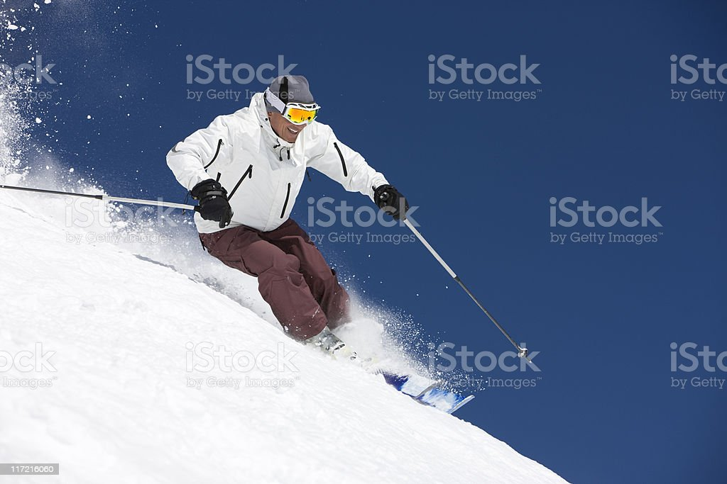 Snow Skier Against Blue Sky royalty-free stock photo