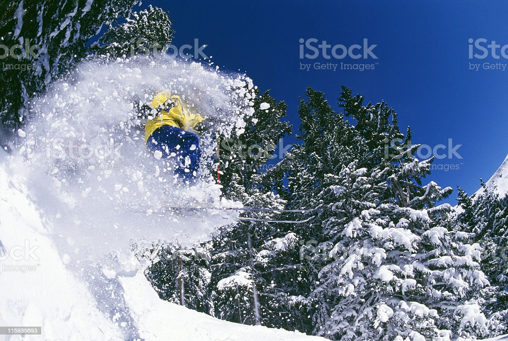 Snow Skier and Wave of Powder royalty-free stock photo