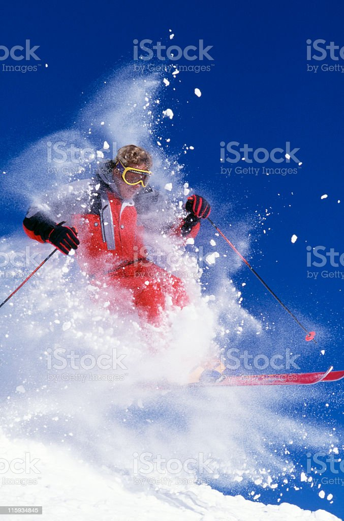 Snow Skier Blasting Through Fresh Powder royalty-free stock photo