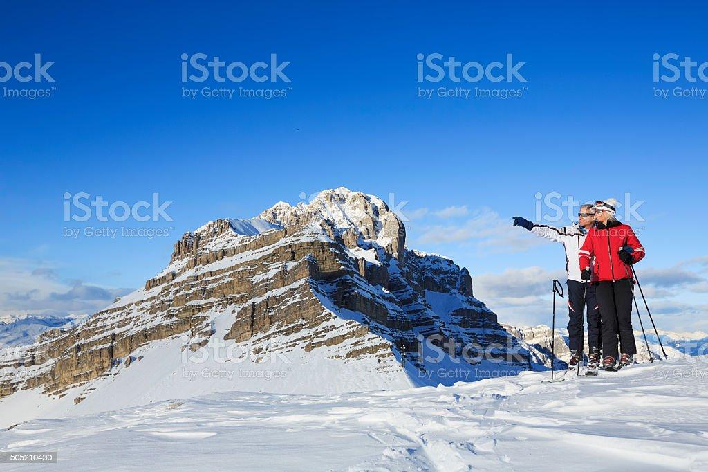 Snow Skier couple  enjoy at  view of the Dolomiti stock photo