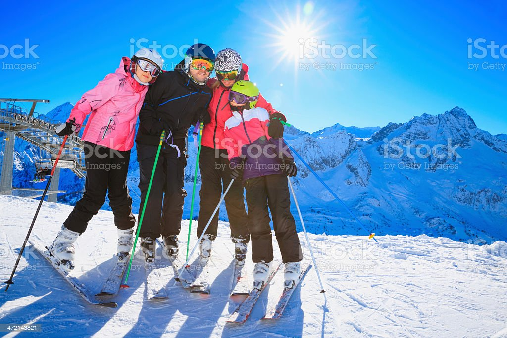 Snow skier family mother and father with children stock photo