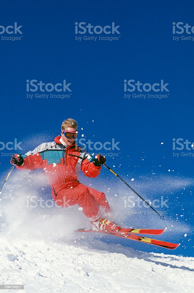 Snow Skier Flying Over Mogul Against Blue Sky royalty-free stock photo