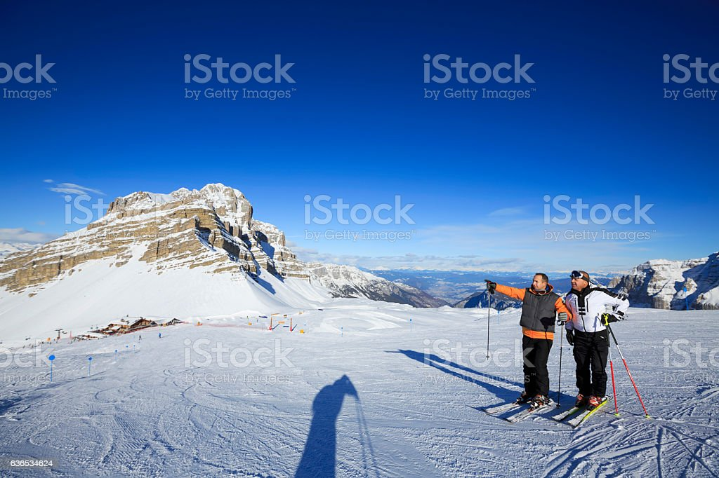 Snow skier Friends enjoy at  view of the Dolomiti stock photo