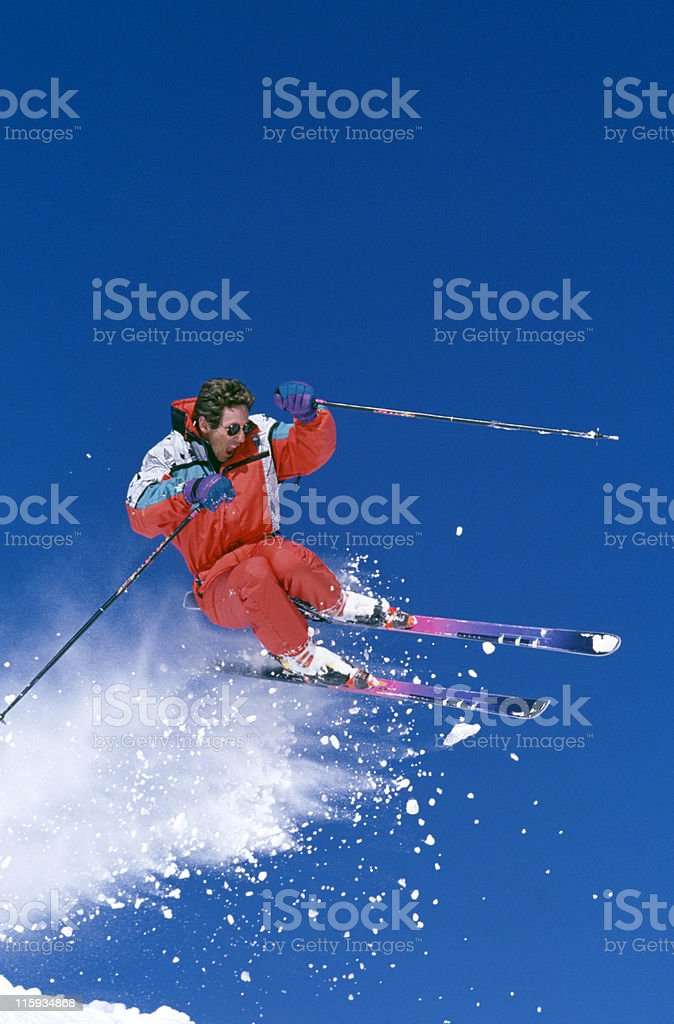 Snow Skier Jumping Against Blue Sky stock photo