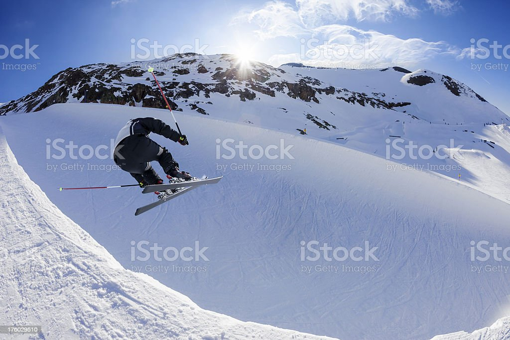 Snow skier jumping - Half Pipe stock photo