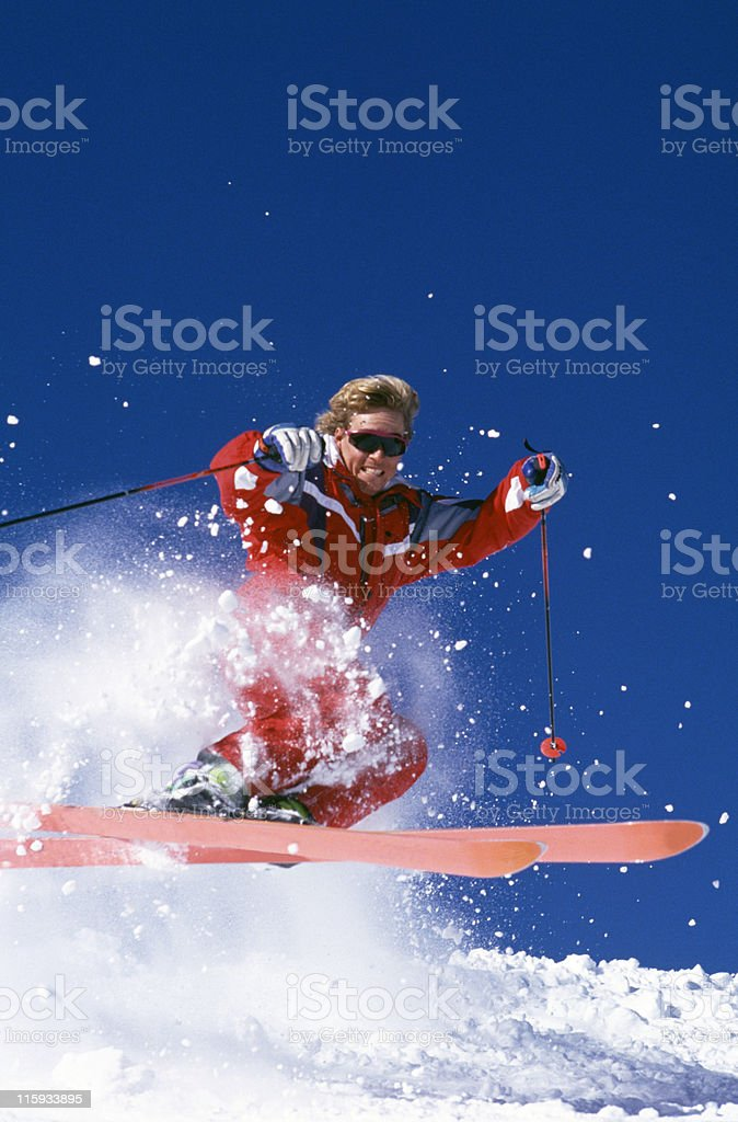 Snow Skier Jumping in Powder royalty-free stock photo
