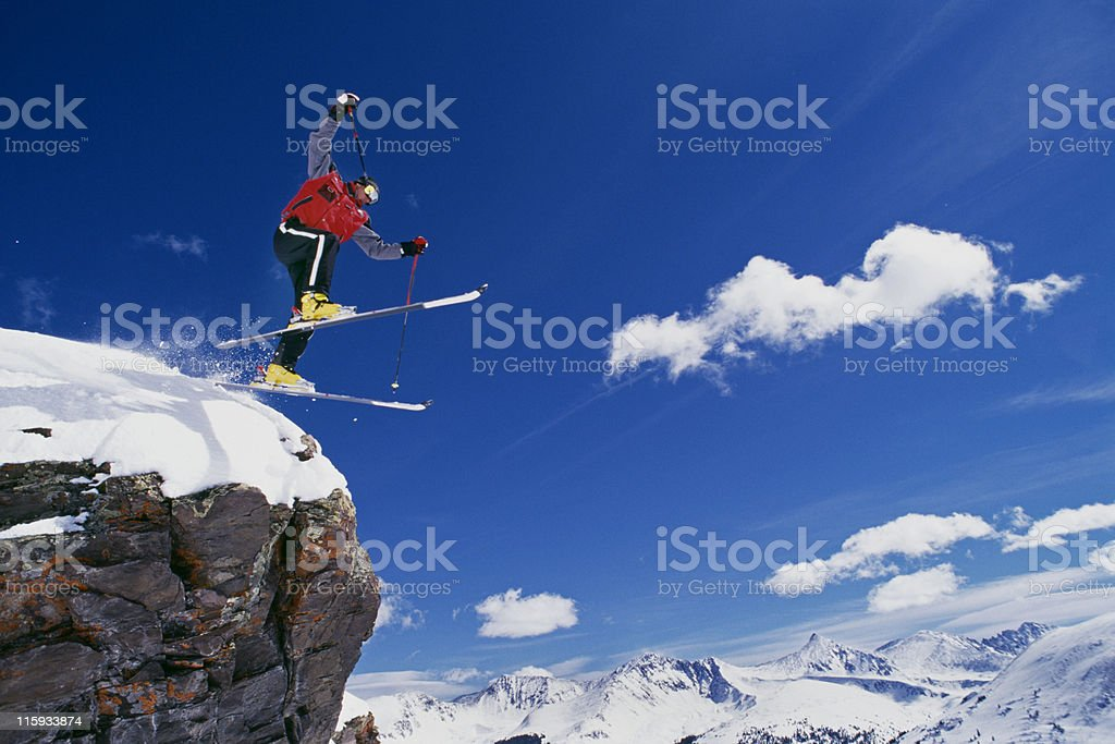 Snow Skier Jumping off Rock royalty-free stock photo