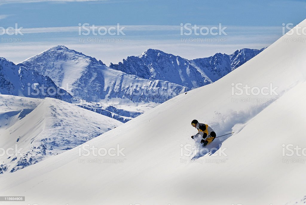 Snow Skier Making First Tracks with Mountain View royalty-free stock photo