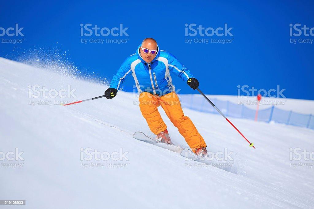 Snow skier skiing stock photo