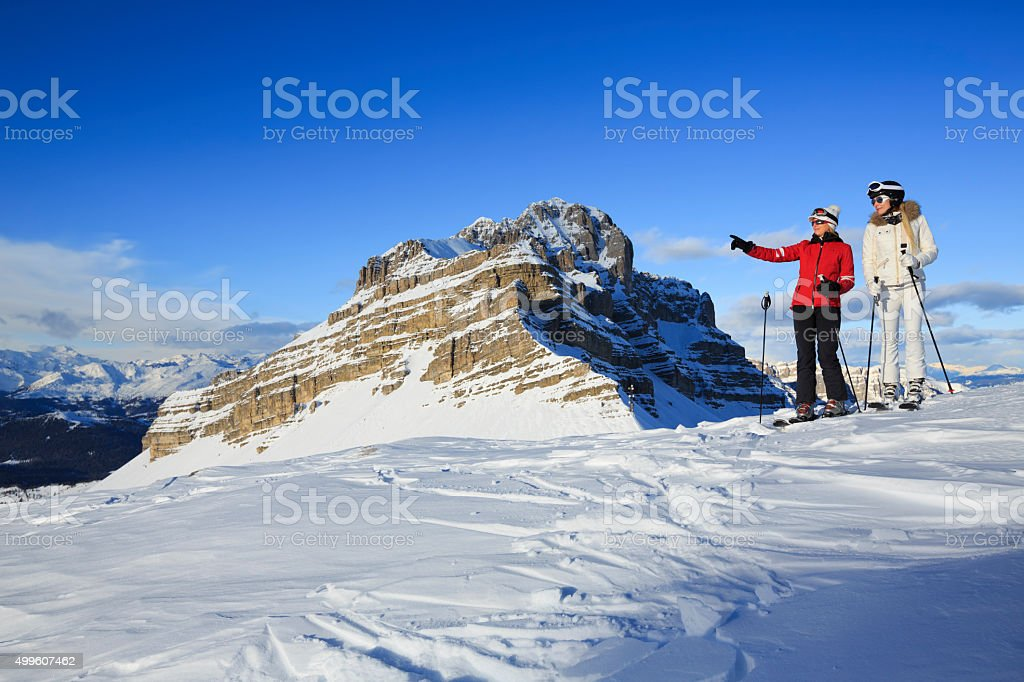 Snow Skier  Two woman enjoy at  view of the Dolomiti stock photo