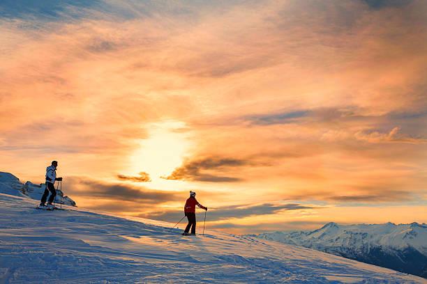 Snow skiers couple enjoying a beautiful winter mountains sunset picture id499289388?b=1&k=6&m=499289388&s=612x612&w=0&h= hbc9fp9n58lslroo7g 29ibxn6kc6ansxqexlwzoda=
