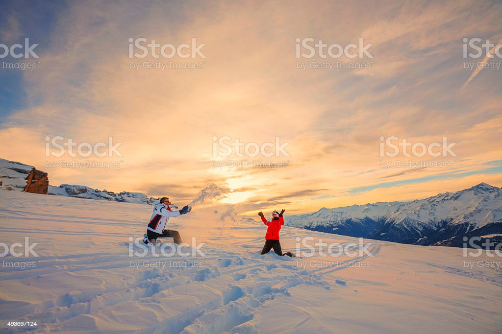 Snow skiers couple  Enjoying  Play  Beautiful winter mountains  sunset landscape stock photo