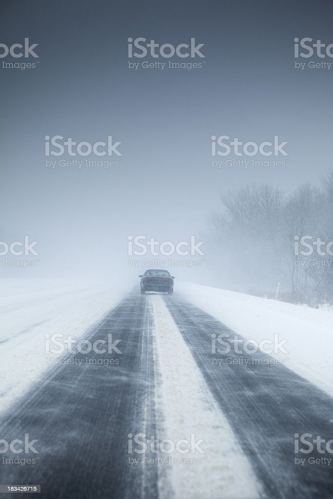 Snow storm on the highway royalty-free stock photo