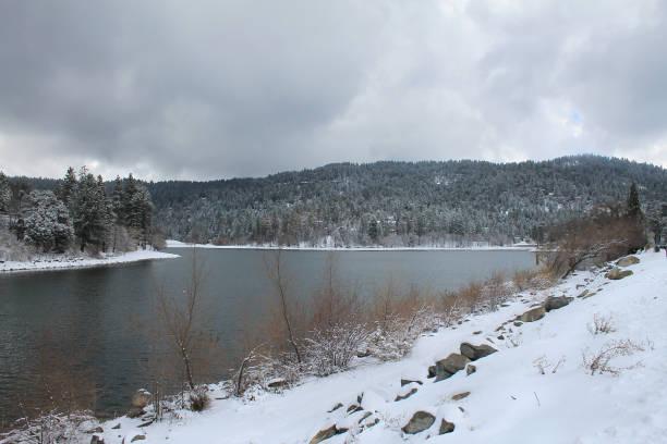 Snow storm passing through Lake Gregory, California stock photo