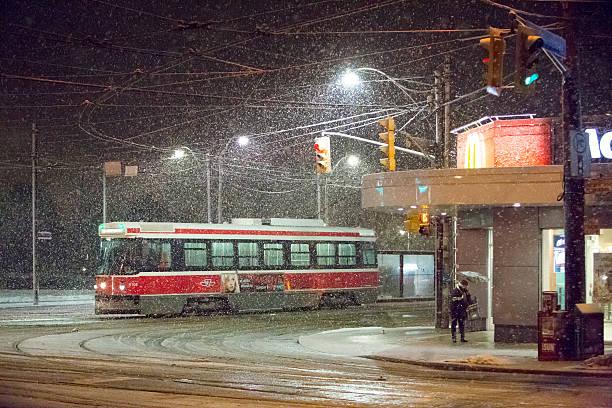 snow storm - toronto streetcar stock photos and pictures