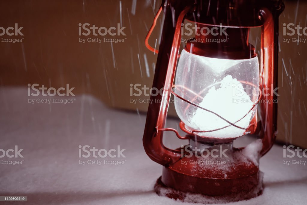 Snow storm red lantern in snow with falling snow stock photo