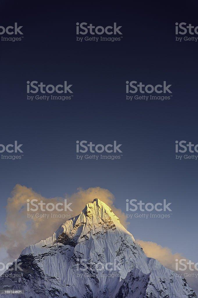 Snow summit sunset golden peak blue sky Himalayas Nepal stock photo