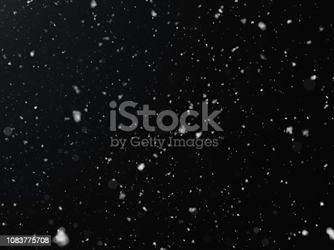 istock Snow texture on black background for overlay 1083775708