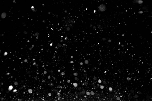 Snow texture on black background for overlay stock photo