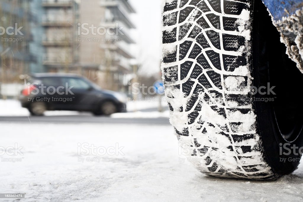 Snow tire, winter road conditions stock photo