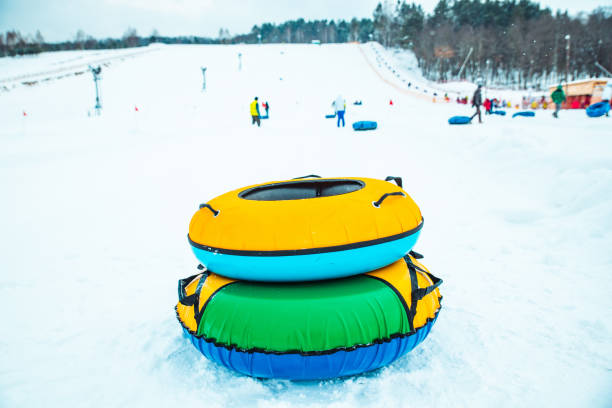 snow tubing rings close up. hill on background stock photo