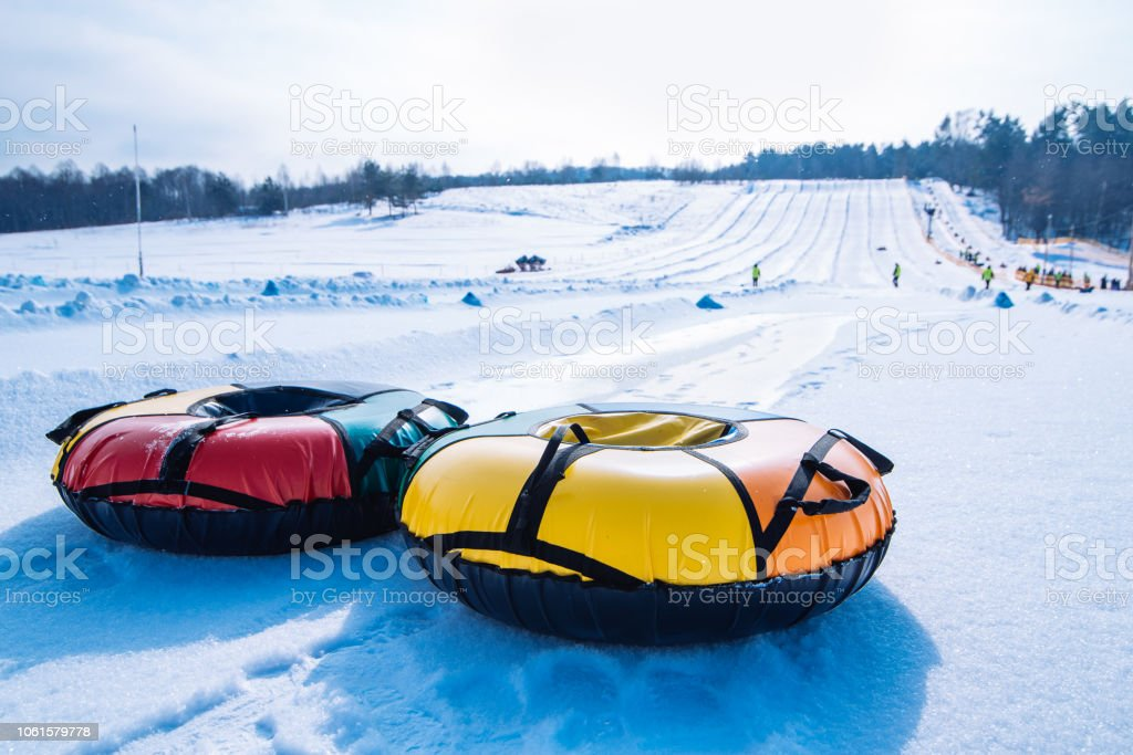snow tubing. sleigh on the top of the hill. winter activity stock photo
