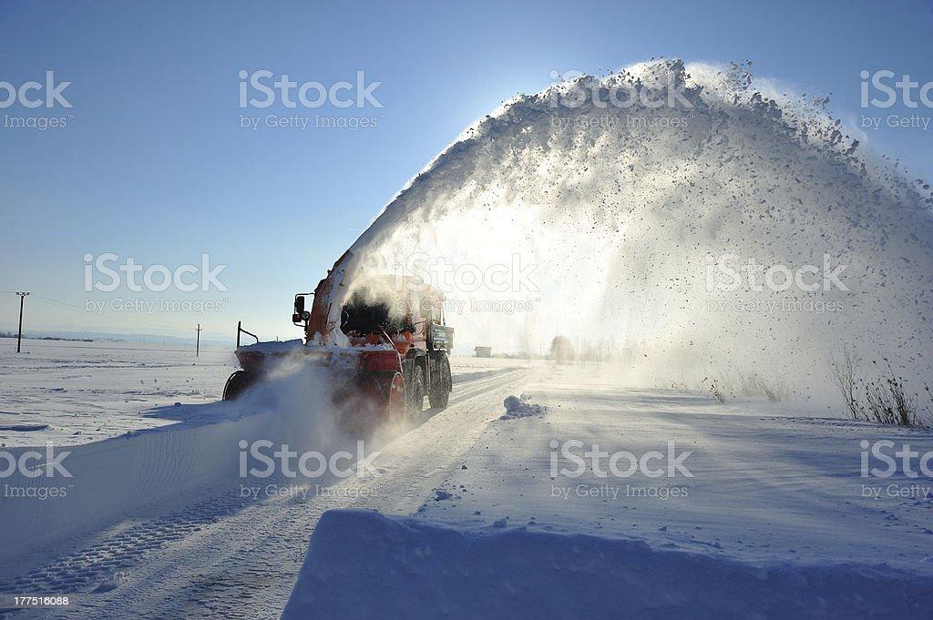 snow vehicle working stock photo
