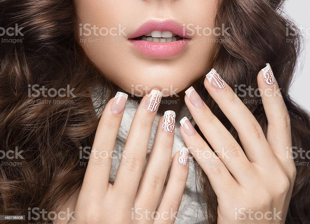 Snow White manicure on female hands. Winter nail design. stock photo