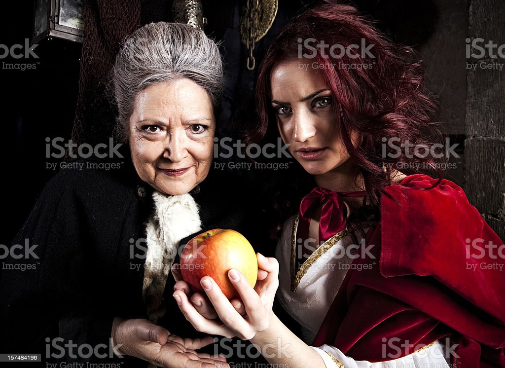 Snow White: Transformation of the queen royalty-free stock photo