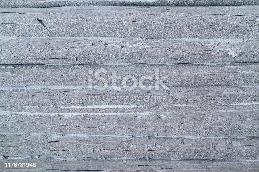 istock Snow white wooden background 1176731948