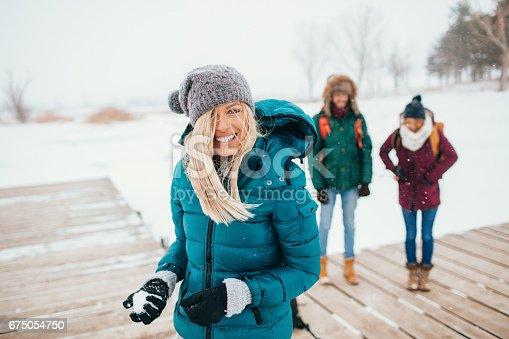 Friends having fun in a winter day