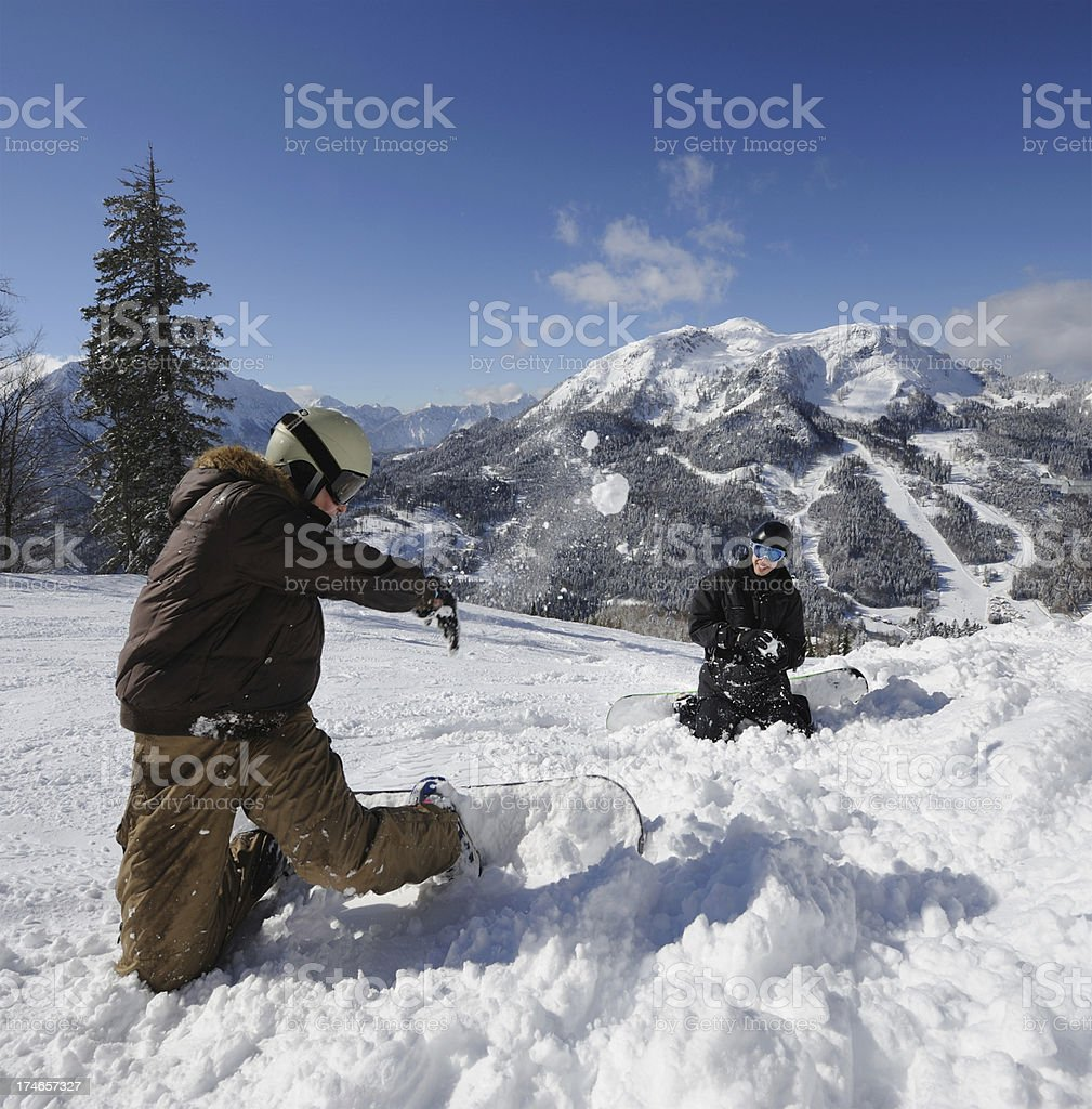 Snowball Fun - Snow fight on the slopes in Powder royalty-free stock photo
