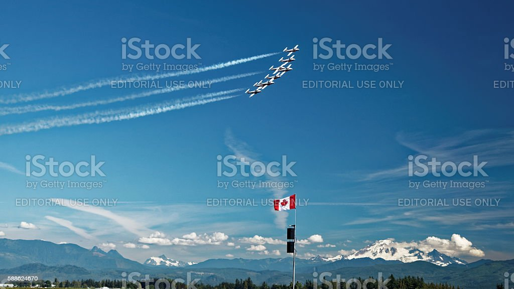 Snowbirds flying in formation over the Canadian Rocky Mountains stock photo