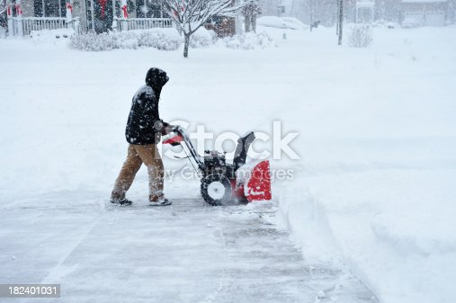 An unidentifiable person Snow Blowing During Blizzard in 18 inch Deep Accumulation of Snow. Model Release Atached.