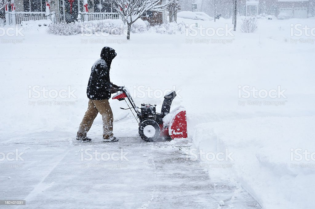 Snowblower During Blizzard in Deep Snow Accumulation stock photo