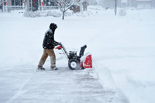 Snowblower During Blizzard in Deep Snow Accumulation stock photo