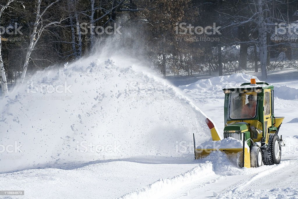 Snowblower truck working outside on a sunny day stock photo