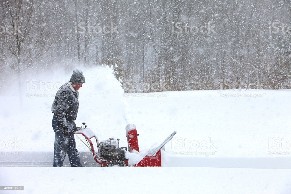 Snowblowing in a snowstorm stock photo