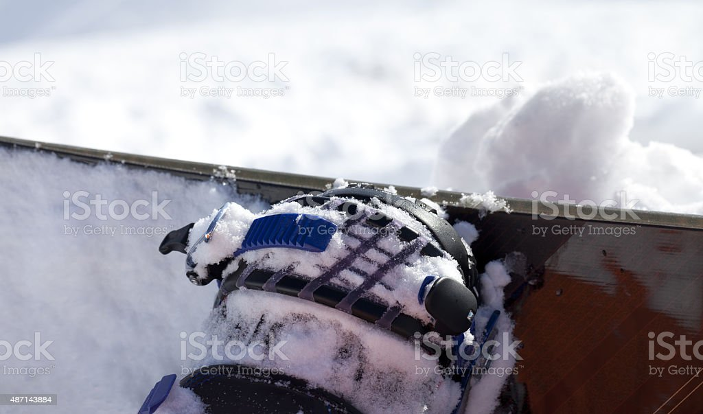 Snowboard and boot in binding on off-piste slope stock photo