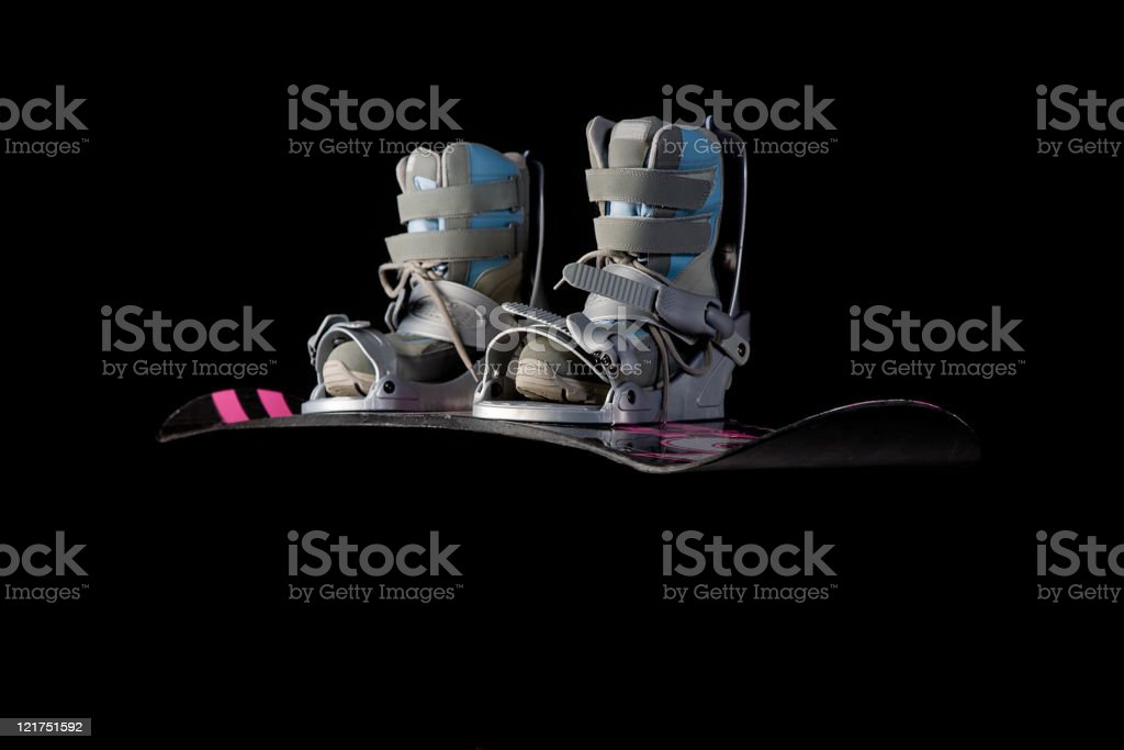 Snowboard and Boots on Black stock photo