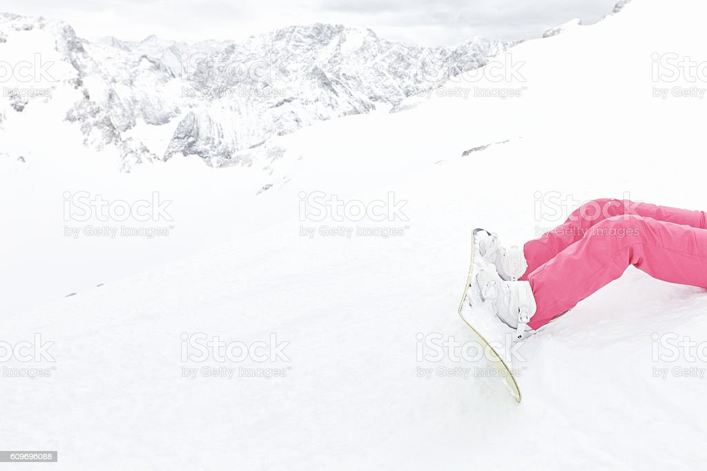 Snowboard, boots and pants closeup stock photo