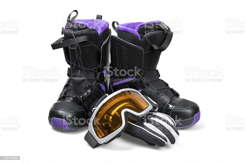 Snowboard boots with gloves and goggles stock photo