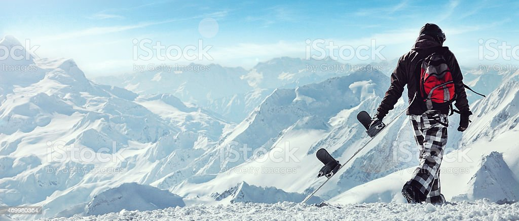 Snowboard freerider  in the mountains stock photo