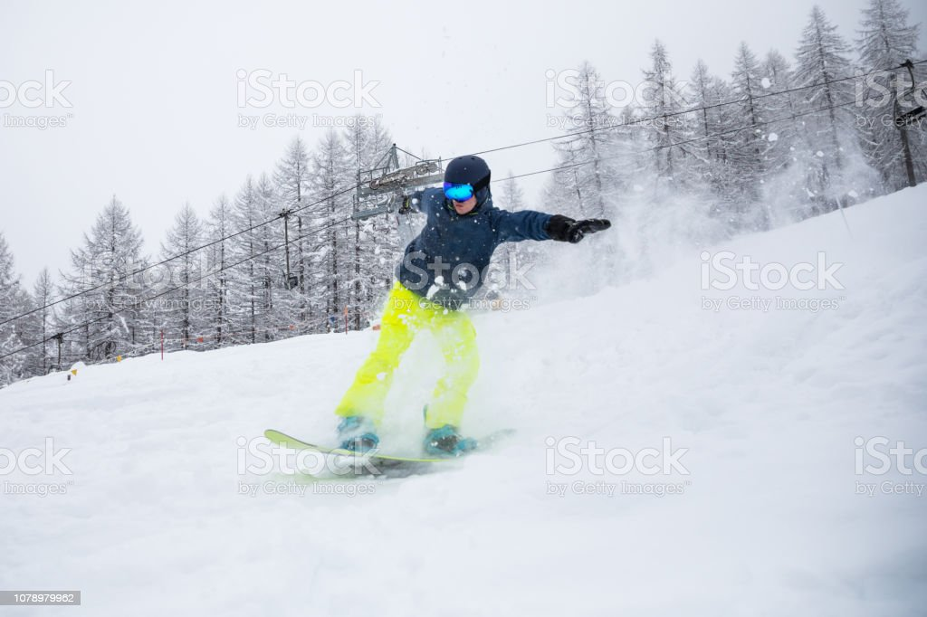 Snowboard freestyle - Young man playing in mountain stock photo
