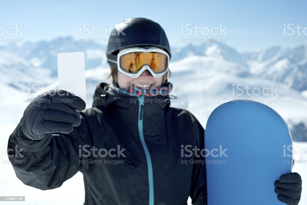 Snowboard girl with blank card smiling stock photo