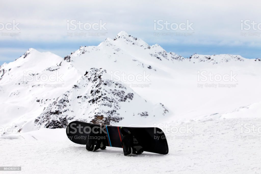 Snowboard on a background of high mountain of Elbrus royalty-free stock photo