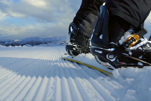 Snowboard on  fresh track close-up rear