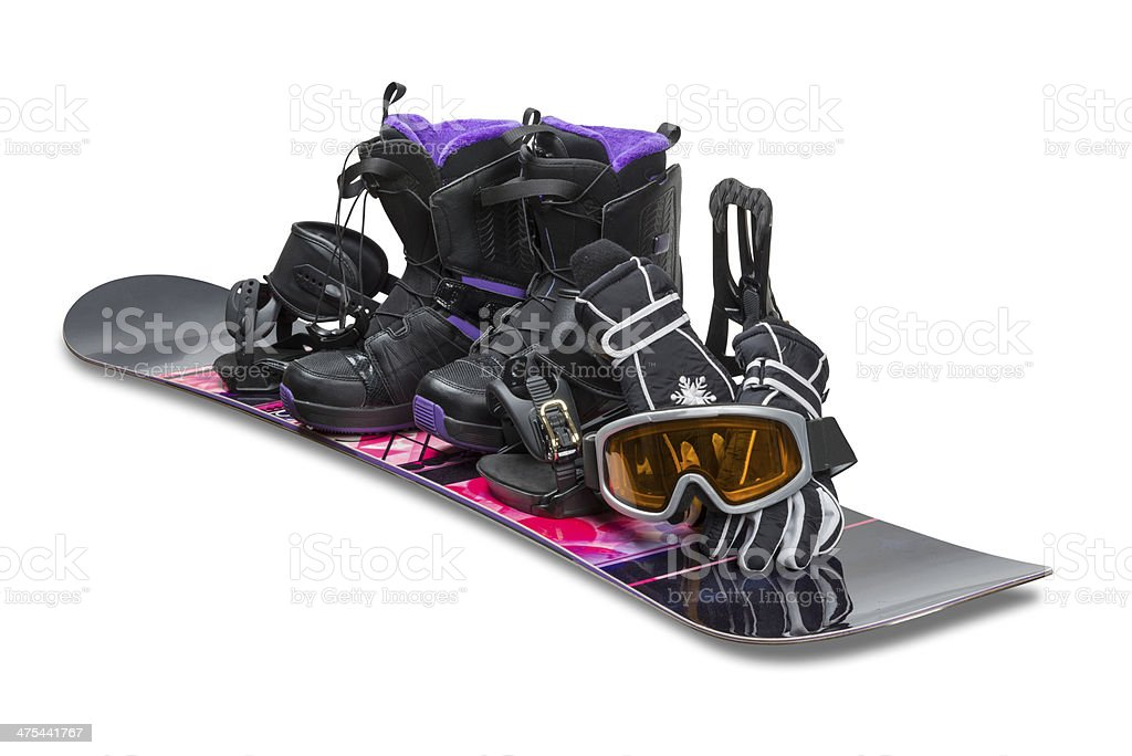 Snowboard with boot, gloves and goggles stock photo