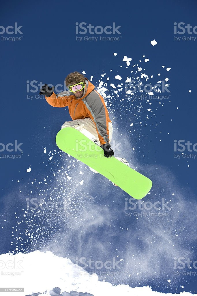 Snowboarder Against A Bright Blue Sky royalty-free stock photo